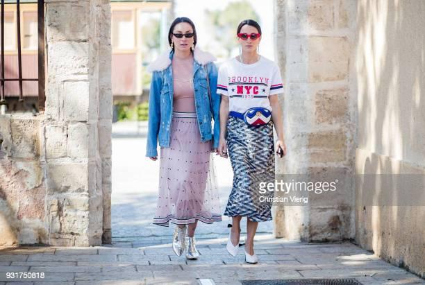 Anna Aronov wearing denim jacket and Meital Katz wearing white tshirt with Brooklyn printed metallic midi skirt Gucci fanny bag is seen during Tel...