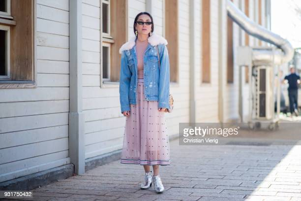 Anna Aronov wearing denim jacket pink skirt and top metallic silver boots is seen during Tel Aviv Fashion Week on March 13 2018 in Tel Aviv Israel