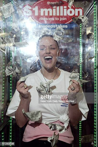 Anna Benson wife of New York Mets' pitcher Kris Benson demonstrates how the money machine works as she promotes the There's a Million Reasons to Join...