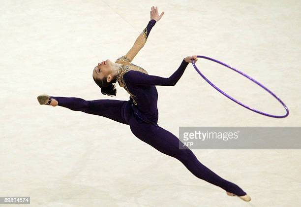 Anna Bessonova of Ukraine performs with a hoop during rhythmic gymnastics World Cup 2009 competition in Kiev on August 16 2009 AFP PHOTO/GENYA SAVILOV