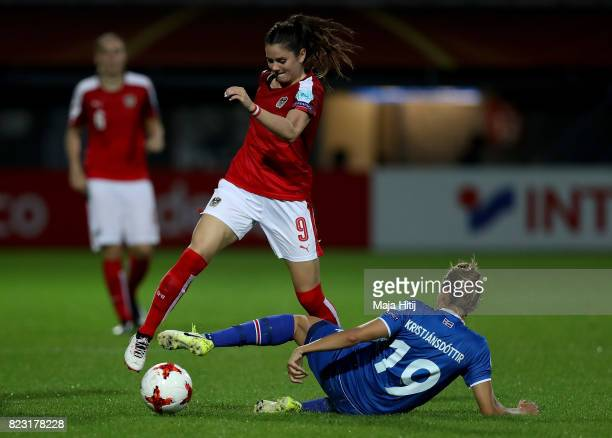 Anna Bjork Kristjansdóttir of Iceland and Sarah Zadrazil of Austria compete for the ball during the Group C match between Iceland and Austria during...