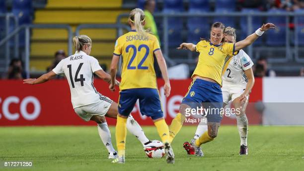 Anna Blaesse of Germany and Lotta Schelin of Sweden battle for the ball during the Group B match between Germany and Sweden during the UEFA Women's...