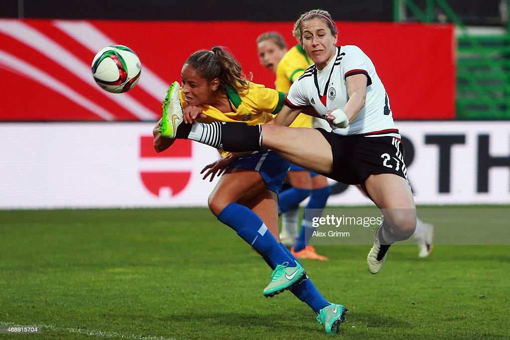 Anna Blaesse (front) of Germany is challenged by Monica of Brazil during the Women's International Friendly match between Germany and Brazil at Trolli-Arena on April 8, 2015 in Fuerth, Germany.