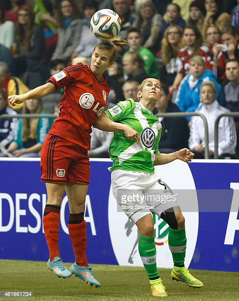 Anna Blaesse of VfL Wolfsburg jumps for a header with Anna Gasper of Bayer 04 Leverkusen during the DFB Women's Indoor Football Cup 2015 match...