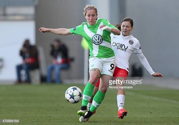 Anna Blaesse of Wolfsburg is attacked by Laure Boulleau of Paris SaintGermain during the first UEFA Women's Champions League semi final match between...