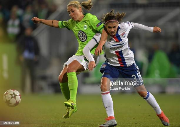 Anna Blaesse of Wolfsburg is challenged by Alex Morgan of Lyon during the UEFA Women's Champions League Quater Final first leg match between VfL...