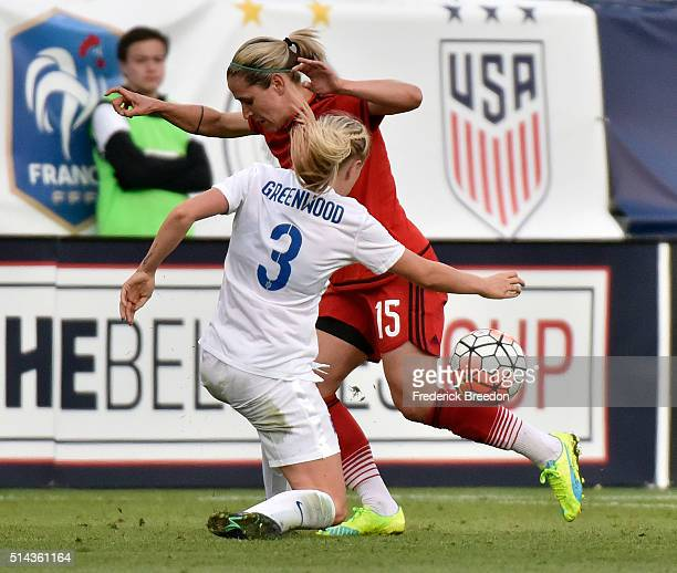 Anna Bl'u008asse of Germany plays against Alex Greenwood of England in a friendly international match in the Shebelieves Cup at Nissan Stadium on...