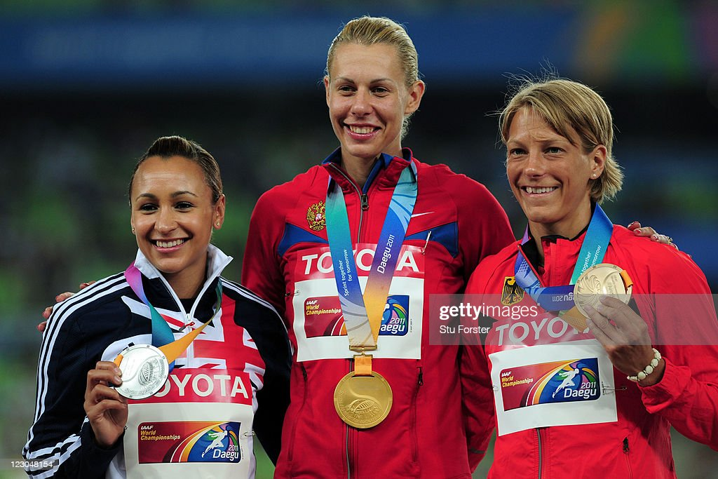 Anna Bogdanova of Russia poses with the gold medal and Jessica Ennis of Great Britain (L) and Jennifer Oeser of Germany (R) after the women's heptathlon during day four of the 13th IAAF World Athletics Championships at the Daegu Stadium on August 30, 2011 in Daegu, South Korea.