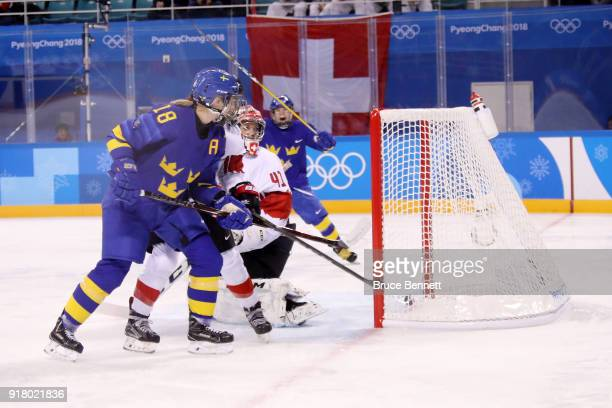 Anna Borgqvist of Sweden scores a goal against Switzerland during the Women's Ice Hockey Preliminary Round Group B game on day five of the...