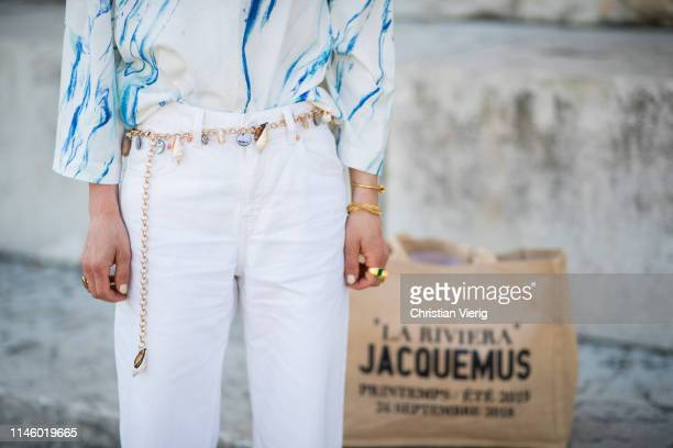 Anna Borisovna is seen wearing Jacquemus bag, white cropped pants, top with print on April 18, 2019 in Munich, Germany.
