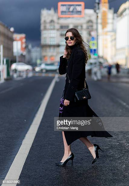 Anna Brain wearing a black J Brand turtlneck Trends Brands apron Anton Lisin coat Deichmann bag vintage rings on October 15 2016 in Moscow Russia