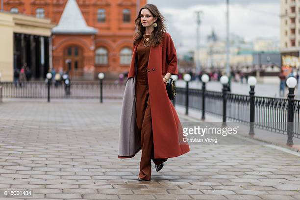 Anna Brain wearing a Mellow coat Maje overall All Saint pumps vintage necklace Anna Azevich bag on October 15 2016 in Moscow Russia