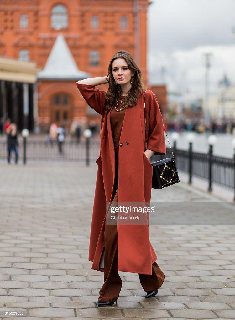 Anna Brain wearing a Mellow coat, Maje overall, All Saint pumps