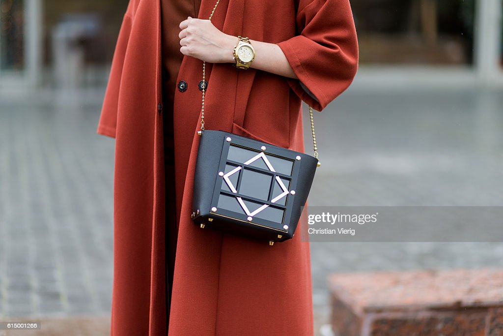 Anna Brain wearing a Mellow coat, Maje overall, vintage necklace