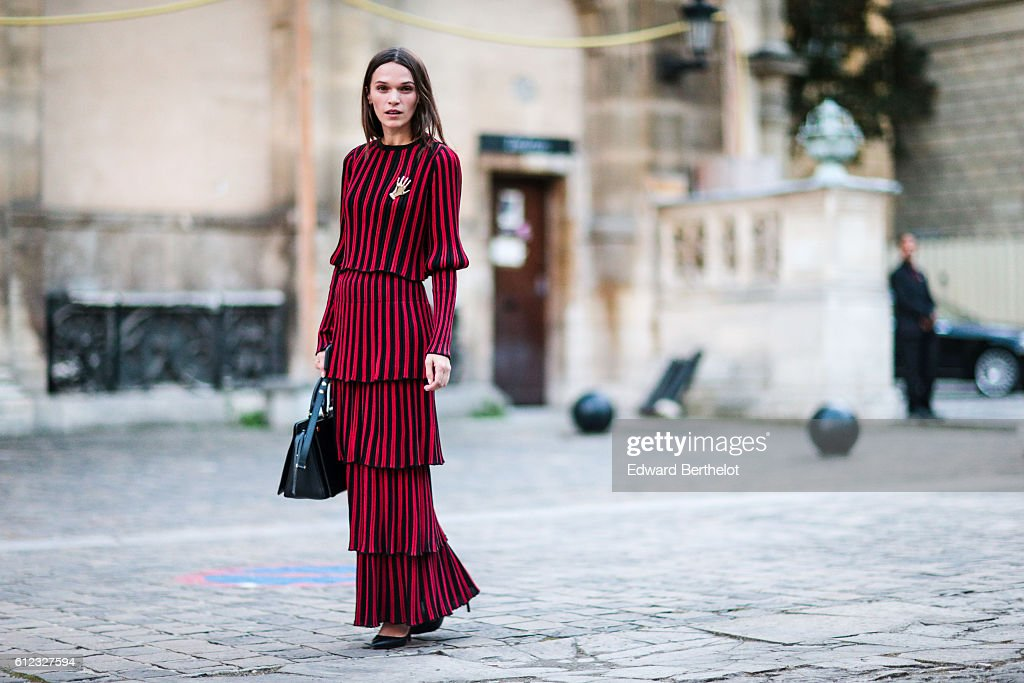 Anna Brewter wears a red and black striped dress, outside of the Sonia Rykiel show during Paris Fashion Week Spring Summer 2017, on October 3, 2016 in Paris, France.