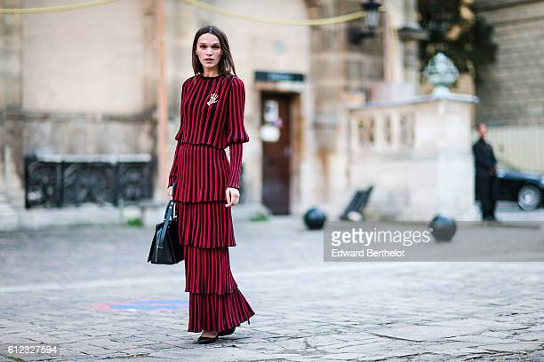 Anna Brewter wears a red and black striped dress outside of the Sonia Rykiel show during Paris Fashion Week Spring Summer 2017 on October 3 2016 in...