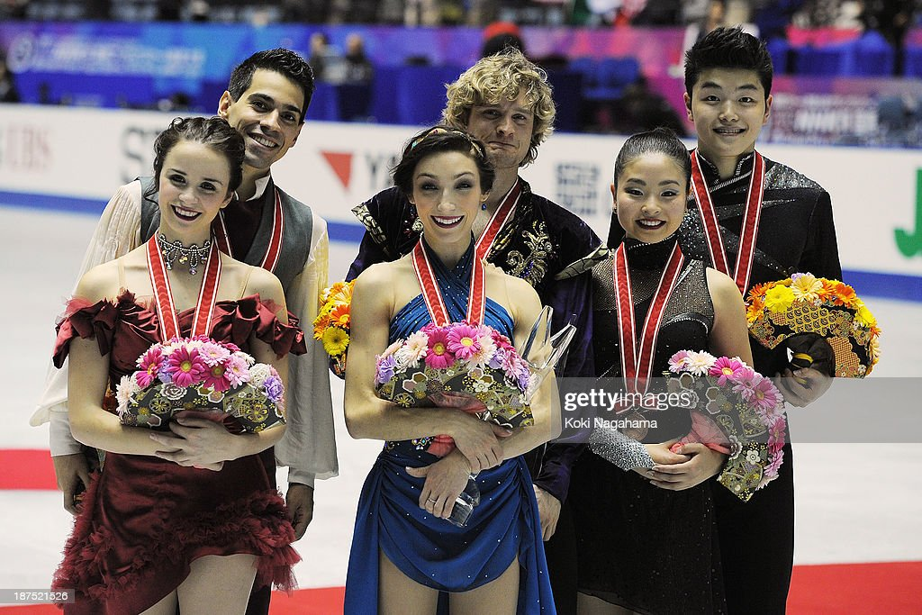 Anna Cappellini and Luca Lanotte of Italy and Meryl Davis and Charlie White of The United States and Maia Shibutani and Alex Shibutani of The United States pose for photographs during day three of ISU Grand Prix of Figure Skating 2013/2014 NHK Trophy at on November 10, 2013 in Tokyo, Japan.