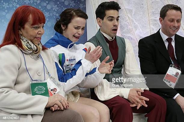 Anna Cappellini and Luca Lanotte of Italy react to their first place score as coaches Paola Mezzadri and Igor Shpilband watch on in the Ice Dance...