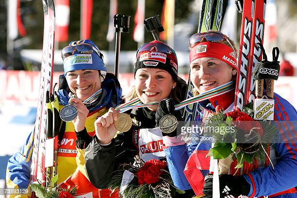 Anna Carin Olofsson of Sweden second place Magdalena Neuner of Germany first place Natalia Guseva of Russia third place celebrate after the IBU...