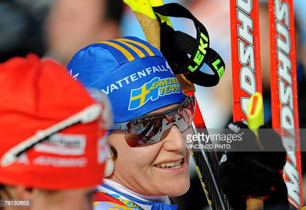 Anna Carin Olofsson of Sweden smiles in the finish area of the Women World Cup Biathlon's 125 km mass start 20 January 2008 in Anterselva German...