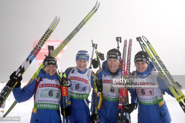 Anna Carin Zidek of Sweden celebreates the victory with her team mates Helena Eckholm, Anna Maria Nilsson and Jenny Jonsson after the women's relay...