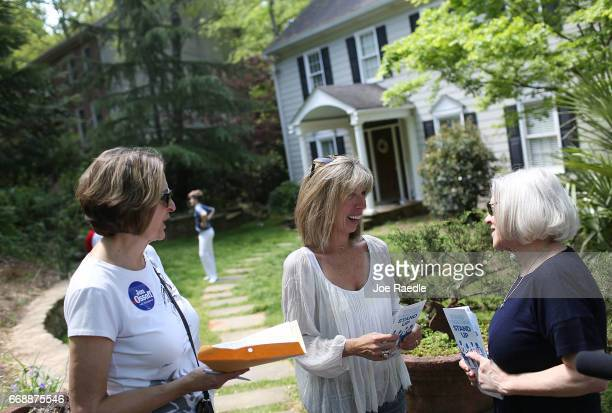 Anna Cay Robertson and Christina Ferguson speak with Nona Bickers as they canvass a neighborhood for Democratic candidate Jon Ossoff as he runs for...