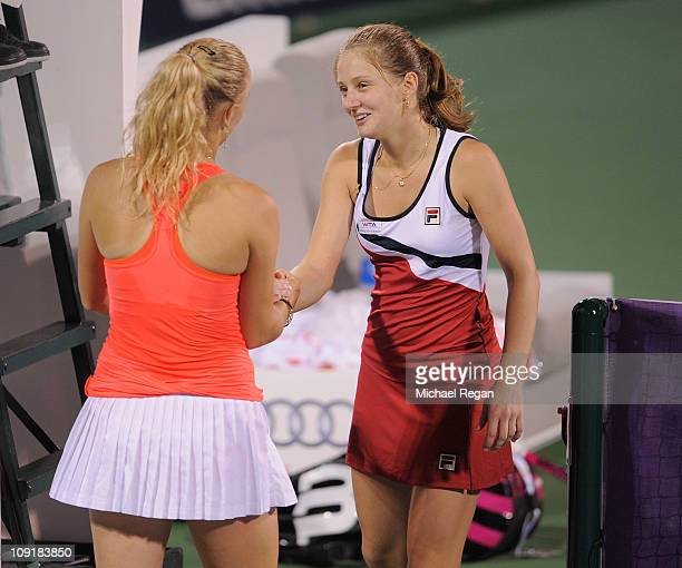 Anna Chakvetadze of Russia is consoled by Caroline Wozniacki of Denmark after collapsing and retiring during their Round 2 match during day three of...