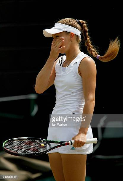 Anna Chakvetadze of Russia looks dejected after missing a shot in her match to Justin HeninHardenne of Belgium during day five of the Wimbledon Lawn...