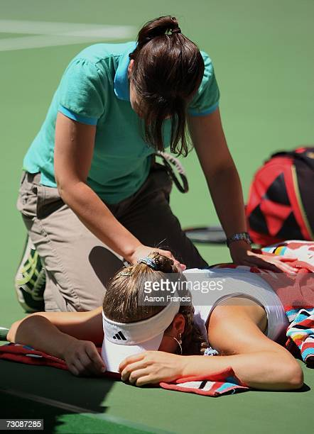 Anna Chakvetadze of Russia receives medical treatment during her quarterfinal match against Maria Sharapova of Russia on day ten of the Australian...