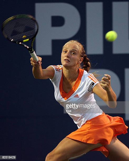 Anna Chakvetadze of Russia returns a shot to Amelie Mauresmo of France during Day 5 of Pilot Pen Tennis on August 22, 2008 at Connecticut Tennis...