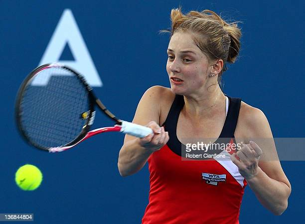 Anna Chakvetadze of Russia returns a shot to Shahar Peer of Israel during day five of the 2012 Hobart International at Domain Tennis Centre on...