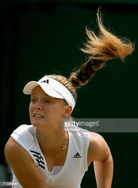 Anna Chakvetadze of Russia serves to Justin HeninHardenne of Belgium during day five of the Wimbledon Lawn Tennis Championships at the All England...