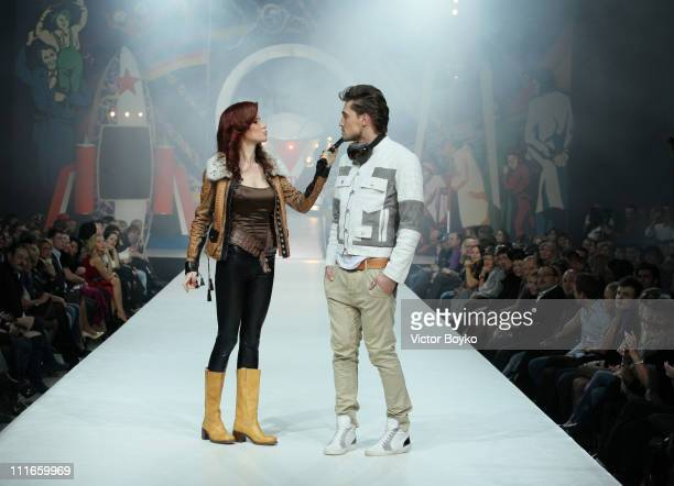 Anna Chapman and singer/model Dima Bilan walk on the runway during the Shiyan Rudkovskaya show at Moscow Fashion Week on April 04 2011 in Moscow...