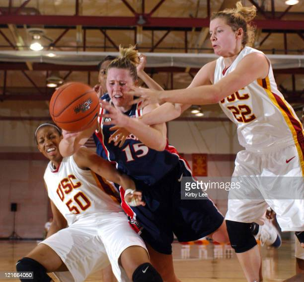Anna Chappell of Arizona battles for loose ball with Chloe Kerr of USC and Allison Jaskowiak in Pacific10 Conference women's basketball game USC...
