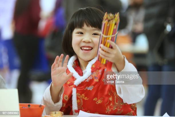 Anna Chen 4 years old is happy to use pencil crayons to colour at Chinese New year festivities at Markham Milliken Mills Branch library