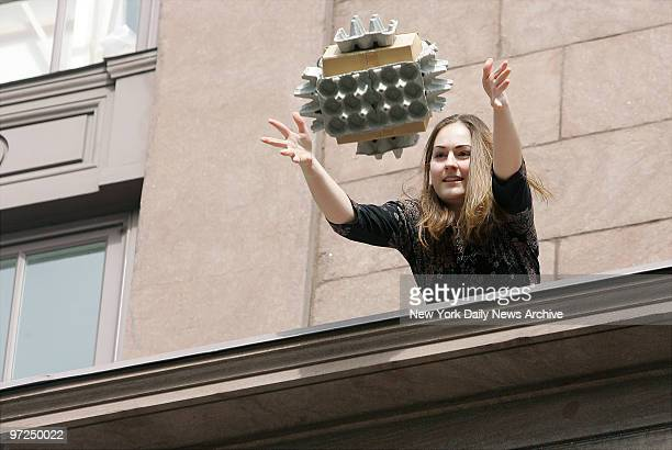 Anna Chernyshenko launches her egg containment contraption from the 3rd floor of the Cooper Union building in Astor Square during the school's annual...