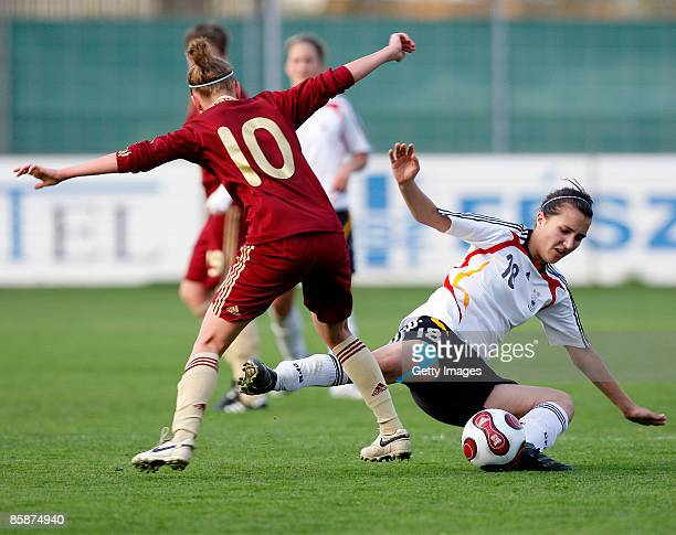 Anna Cholovyaga of Russia and Kyra Malinowski of Germany fight for the ball during the U17 Women international friendly match between Germany and...