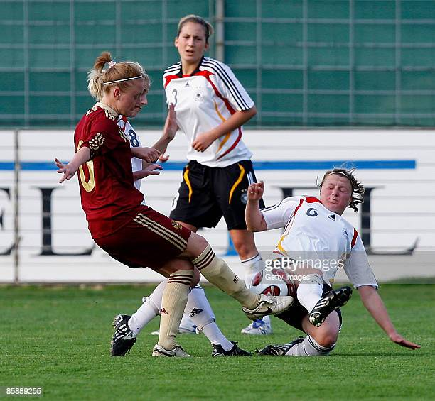 Anna Cholovyaga of Russia challenges Lynn Mester, Laura Vetterlein and Claudia Götte of Germany during the U17 Women international friendly match...