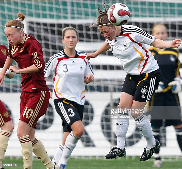 Anna Cholovyaga of Russia, Laura Vetterlein and Claudia Götte of Germany jump for a header during the U17 Women international friendly match between...