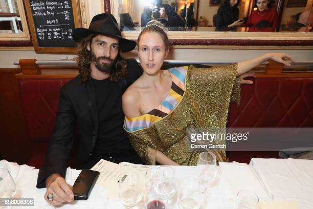 Anna Cleveland and Maximiliano Patane attend a dinner in Paris to celebrate Another Magazine A/W17 hosted by Vivienne Westwood, Andreas Kronthaler,...