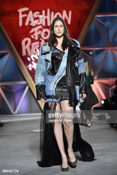Anna Cleveland walks the runway at the Fashion for Relief during the 70th annual Cannes Film Festival at Aeroport Cannes Mandelieu on May 21 2017 in...