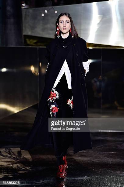 Anna Cleveland walks the runway during the HM show as part of the Paris Fashion Week Womenswear Fall/Winter 2016/2017 on March 2 2016 in Paris France