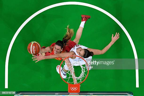 Anna Cruz of Spain goes to the basket against Diana Taurasi of United States during the Women's Gold Medal Game between United States and Spain on...