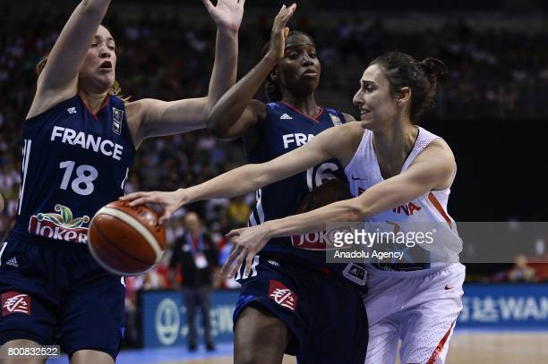 Anna Cruz of Spain in action against Alexia Chartereau and Hhadydia Minte of France during the 2017 FIBA EuroBasket Women gold medal match between...