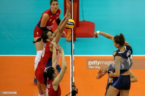 Anna Danesi of Italy spikes against Milena Rasic of Serbia during 2018 FIVB Volleyball Women's World Championship pool G match between Italy and...