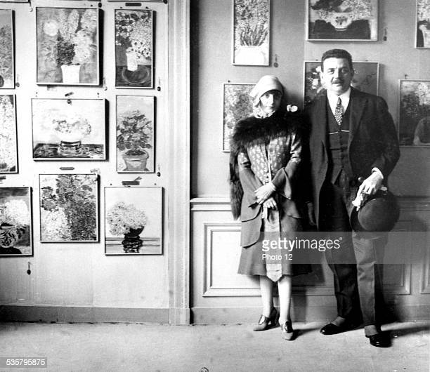 Anna de Noailles with president Edouard Herriot in front of the pastel paintings of her exhibition France Paris National library