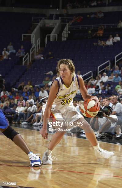 Anna DeForge of the Phoenix Mercury handles the ball during the WNBA game against the Detroit Shock at the America West Arena on August 13, 2003 in...