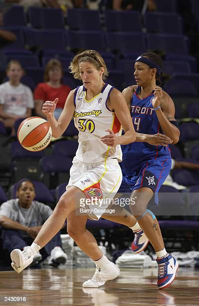 Anna DeForge of the Phoenix Mercury looses the ball as she drives past Deanna Nolan of the Detroit Shock during the WNBA game at the America West...