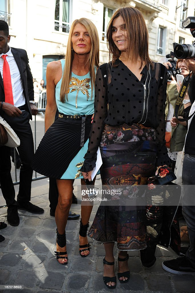 Anna Dello Russo and Carine Roitfeld arrives at Christian Dior Fashion Show during Paris Fashion Week Womenswear Spring/Summer 2014 on September 27, 2013 in Paris, France.