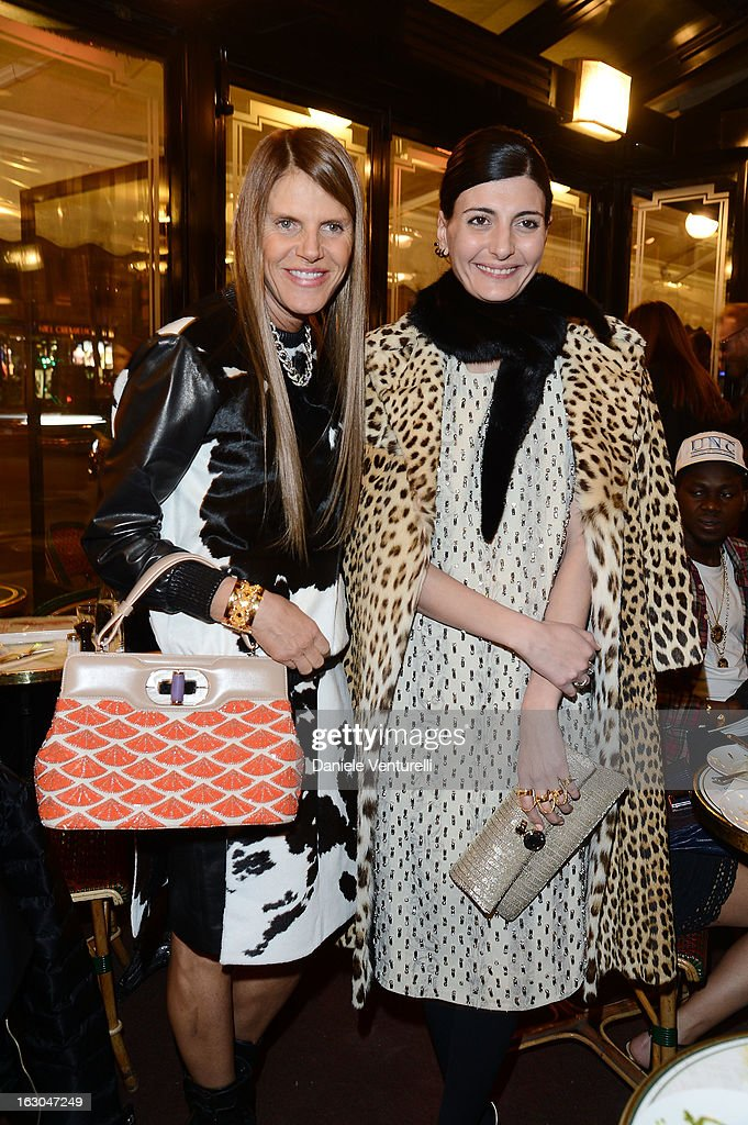 Anna dello Russo and Giovanna Battaglia attend the Bulgari And Purple Magazine Party at Cafe de Flore on March 3, 2013 in Paris, France.